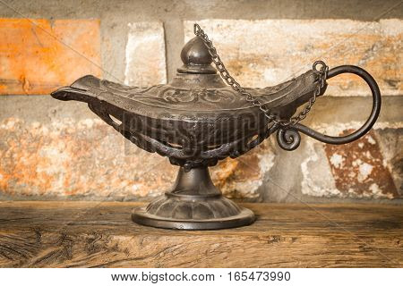 Beautiful vintage Aladdin lamp on the rocky background