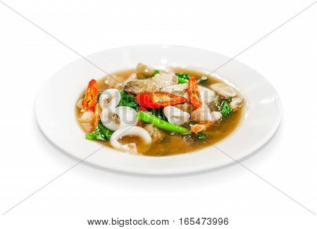 thai food fried noodle with seafood squid sea mussel shrimp mushroom and kale soaked in gravy isolated on white background