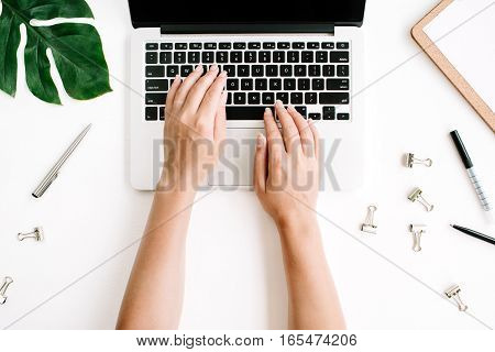 Woman working on laptop. Flat lay top view workspace
