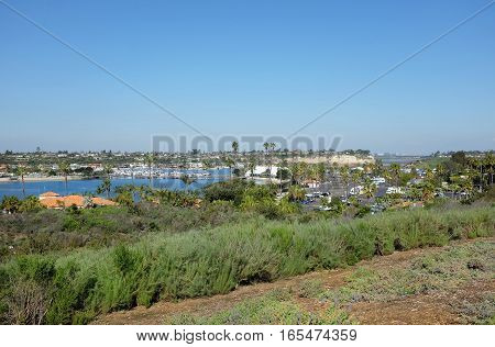 NEWPORT BEACH CALIFORNIA - JANUARY 16 2017: Back Bay View Park Vista. Looking out over Newport Dunes Resort and Upper Newport Back Bay Ecological Reserve.