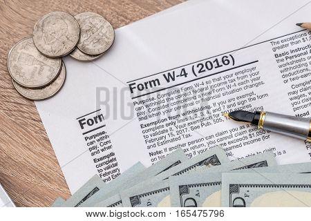 2017 tax form - w4 with money.