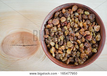 Dried Organic Raisin in Bowl on Wooden BackgroundClose-up. Selective Focus. Copy Space.