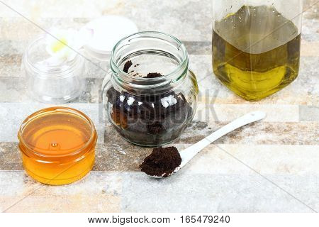 Skin scrub from used coffee grounds honey and olive oil. Good for face acne and body cellulite