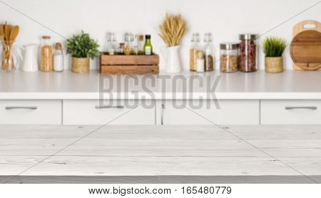 Empty wooden table with bokeh image of kitchen bench interior