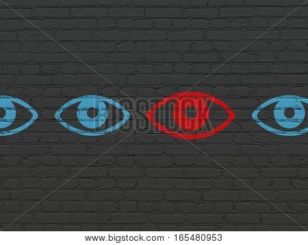 Safety concept: row of Painted blue eye icons around red eye icon on Black Brick wall background