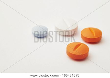 Pills over a white background. Medicament treatment. Health care photo