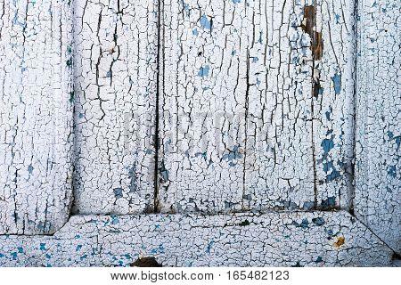 old wood plank textured peeling white paint