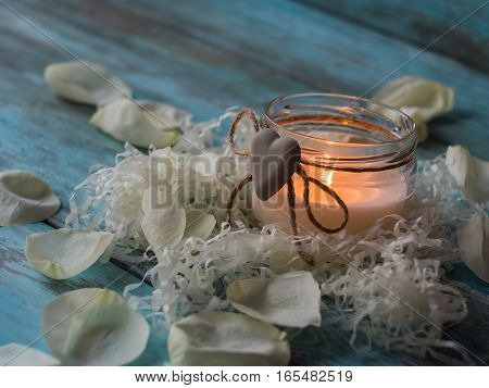 Beautiful candle and rose on wooden background. Close up.