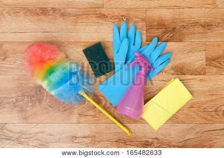 Cleaning tools isolated on a parquet floor