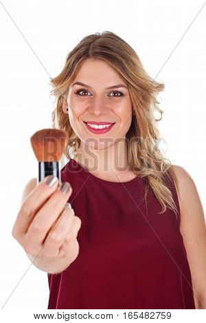 Picture of a beautiful young lady holding a make-up brush