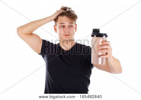Picture of an attractive young man holding a protein shake