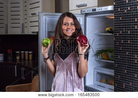Woman In The Dark At The Open Refrigerator