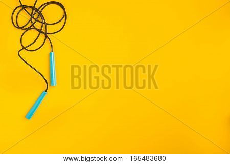 Top view of Skipping rope on yellow background, Fitness lifestyle concept, Free space for text