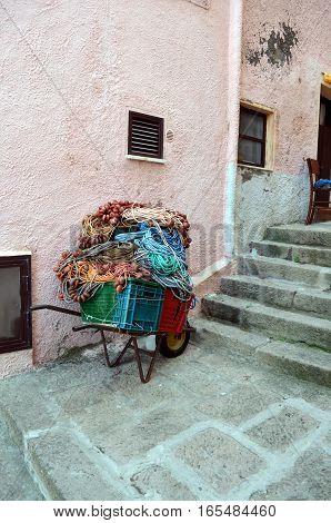 Fishing net in old wheelbarrow in the street