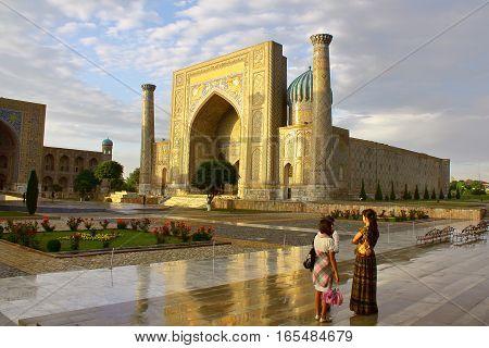 SAMARKAND, UZBEKISTAN - MAY 18, 2011: The Registan after the rain at sunset
