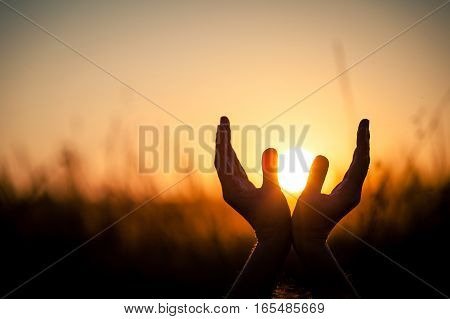 Silhouette Of Female Hands During Sunset.