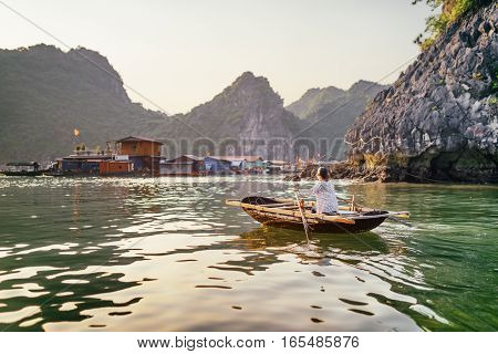 Woman In Boat Returns To Fishing Village, The Ha Long Bay