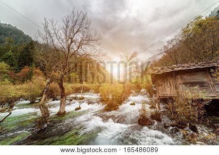 Scenic View Of Wooden House By The Bonsai Shoals, Jiuzhaigou