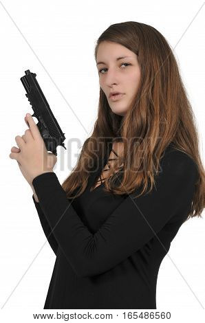 Beautiful young woman holding a loaded handgun