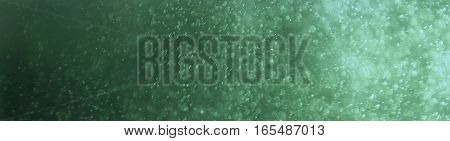 Glitter sparkling abstract green bokeh defocused background, border design panoramic banner