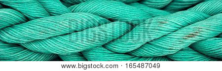 Nautical background. Old blue frayed ship rope closeup, border design panoramic banner