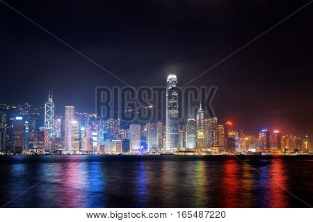 Night View Of Hong Kong Island Skyline Across Victoria Harbor
