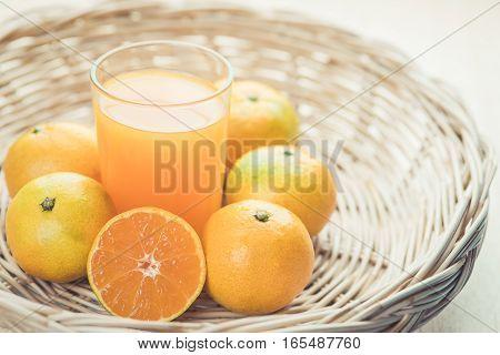 Glass Of Orange Juice A Wicker Basket , Vintage