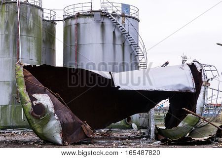 degradation of industrial materials destroyed silos twisted metal decomposition