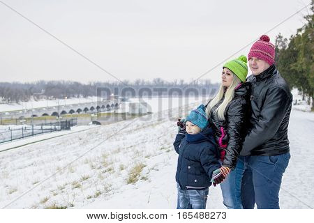 Happy Family On A Winter Walk