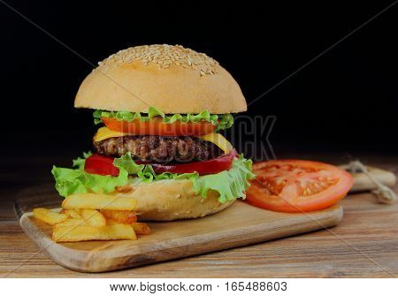 homemade hamburger with beef cutlet,fresh vegetables and French fries