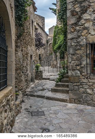 Spain Catalonia Girona Pals .The first mention Pals refer to the 9th century. Very beautiful medieval town . Stone streets buildings cozy little town Square an observation deck . poster