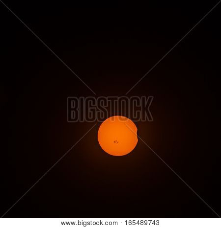 The very beginning of a solar eclips in October 2014 at 5:03 PM.