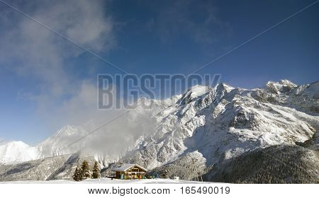 Aerial Drone Views of an Alpine Mountain Valley Covered in Fresh Snow