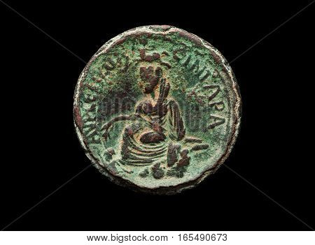 Roman Ancient Bronze Coin In Green Patina Isolated On Black
