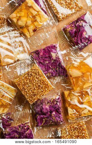 Pile Of Oriental Sweets In Plastic Package