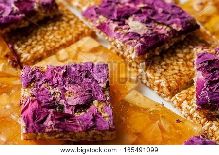 Pile Of Oriental Sweets With Nuts, Seeds And Rose Petals