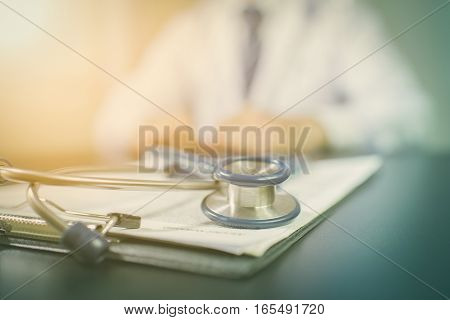 Medicine doctor's working table. Focus on stethoscope vintage tone. Doctor care. Clinic doctor. Office doctor. Technology doctor. Doctor concept. Doctor desk. Doctor room.