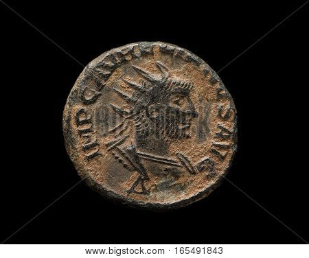Ancient Copper Roman Coin With Ruler Portrait Isolated On Black