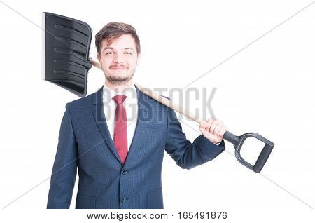 Man Wearing Suit Smiling And Carrying A Snow Shovel