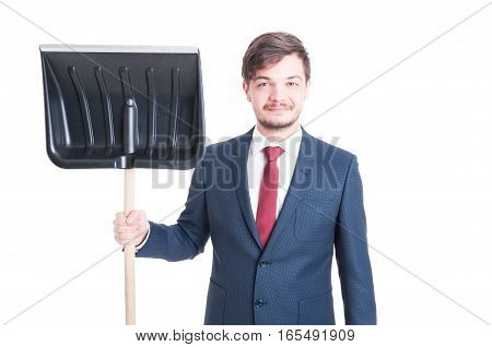 Man Wearing Suit Standing Showing A Snow Shovel