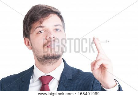 Man Wearing Suit Blowing Smoke From A Cigarette