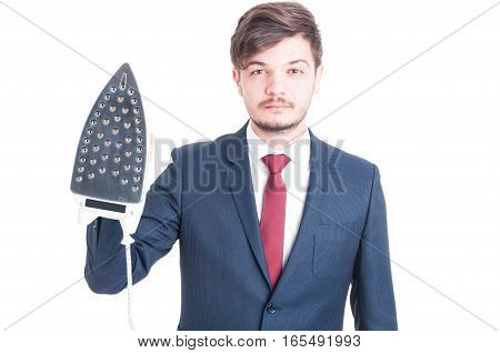 Man Wearing Suit Holding Up An Iron