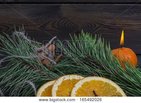 christmas decoration with orange fruit and spices on wooden table