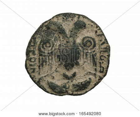 Ancient Islamic Bronze Coin With Image Of Animal Head Isolated On White