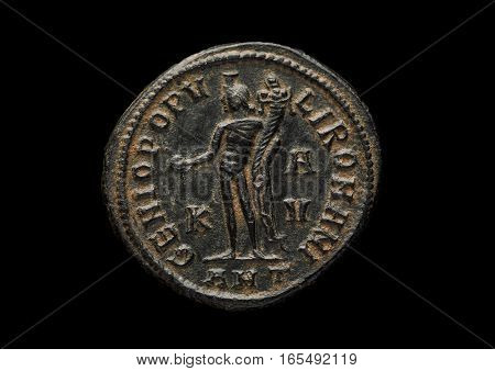Ancient Roman Copper Coin With Warrior Image Isolated On Black