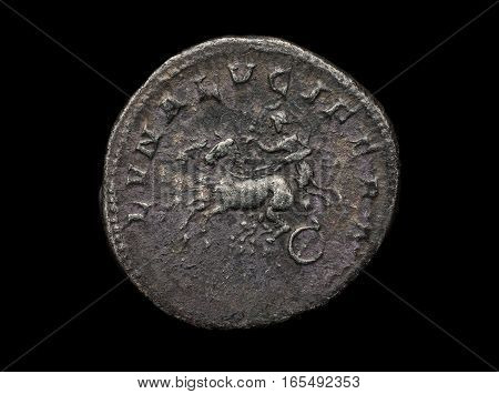 Ancient Silver Coin With Chariot Isolated On Black