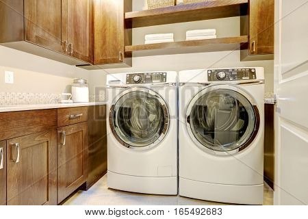 White And Brown Laundry Room With Modern Appliances