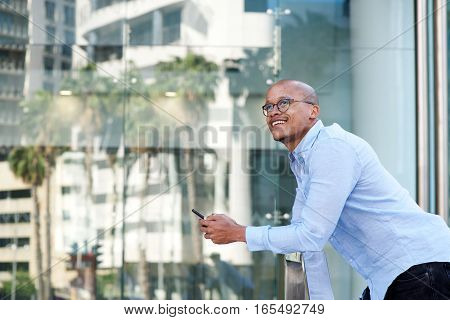 African Businessman Standing Outside With Cellphone