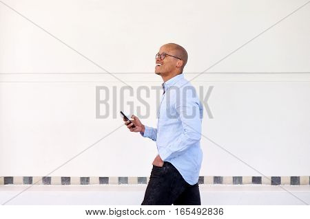 Happy Businessman Walking With Cellphone