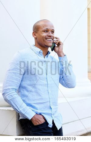 Smiling African Guy With Cellphone